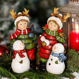 Winterkinder Tom & Lisl mit Schneemännern