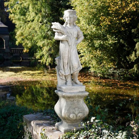 Vierjahreszeiten - Steinfigur Herbst auf Säule