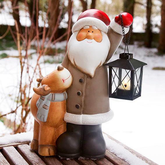Weihnachtsmann mit Rentier Rocky